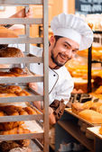 Handsome cook in the kitchen — Stock Photo