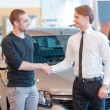 Customer and sales consultant with showroom view on the backgrou — Stock Photo #68171187