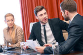 Business conversation at meeting — Stock Photo