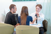 Couple communicating with a salesman — Stock Photo