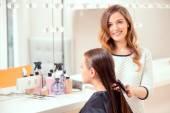 Beautiful woman in hair salon — Stock Photo