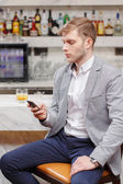 Waiting for friends in the bar — Stock Photo
