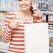 Customer of a pharmacy with  paper bag — Stock Photo #69514309