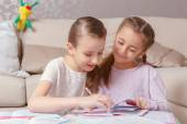 Girls write in note pads — Stock Photo