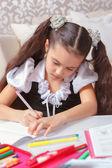 School girl doing writing — Φωτογραφία Αρχείου
