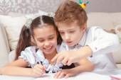 Boy and girl do tasks together — Stock Photo