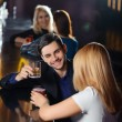 Couple has a drink in bar — Stock Photo #70035901