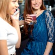 Girl friends have a drink in the bar — Stock Photo #70035957