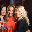 Three women have a drink in the bar — Stock Photo #70036043