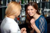 Girl friends have a drink in the bar — Stock Photo