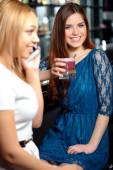 Girl friends have a drink in the bar — Stockfoto