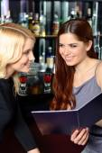 Two friends examine menu — Stock Photo