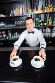 Barman stretches out coffee — Stock Photo