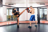 Girl kickboxer and her coach — Stock Photo