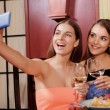 Two friends make selfie in a restaurant — Stock Photo #70631269