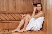 Woman relaxes in sauna — Stock Photo