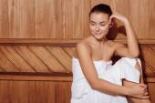 Woman relaxes in a sauna — Stock Photo