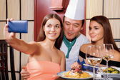 Female clients in restaurant do selfie — Stock Photo