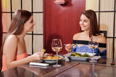 Women interact in a restaurant — Stock Photo
