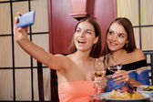Two friends make selfie in a restaurant — Stock Photo
