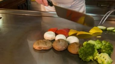 Horizontal dolly shot of chef preparing different vegetables — Stok video