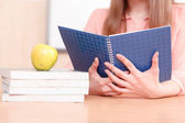 Woman holding blue copy book — Stock Photo