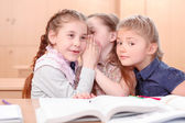 Girls with opened books in classroom — Stock Photo