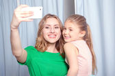 Young woman making selfie in a fitting room — Stock Photo
