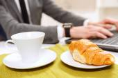 Close up of croissant and cup coffee. — Stock Photo