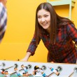Happy friends playing table hockey — Stock Photo #73393007