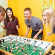 Happy friends playing table hockey — Stock Photo #73392955