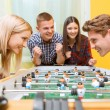 Happy friends playing table hockey — Stock Photo #73393085