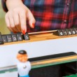 Happy friends playing table hockey — Stock Photo #73393093