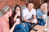 Young people waiting for the order in a cafe — Stock Photo