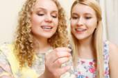 Pair of blond women looking at wedding ring  — Stock Photo