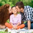 Happy family on a picnic — Stock Photo #74597449