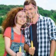 Happy family playing badminton — Stock Photo #74597933