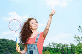 Happy family playing badminton — Stock Photo
