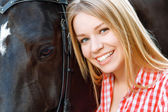 Close up of smiling girl with the horse — Stock Photo