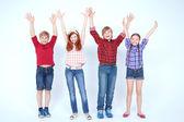 Brightly dressed children smiling — Stock Photo