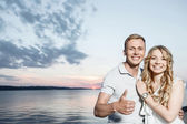 Lovely couple and beautiful sunset — Stock Photo