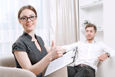 Young man with his psychologist — Stock Photo