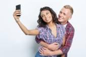 Happy couple making photos — Stock Photo