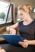 Businesswoman checking time in car — Stock Photo