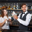 Bartender and a waitress during work — Stock Photo #77055643