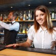 Bartender and a waitress during work — Stock Photo #77055659