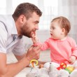 Pleasant young father playing with his child — Stock Photo #77056125