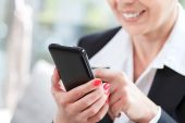 Businesswoman holding her smartphone — Stock Photo