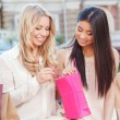 Two friends on the walk after shopping — Stock Photo #77644406