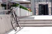 Nice  bicycle leaning on handrail — Fotografia Stock